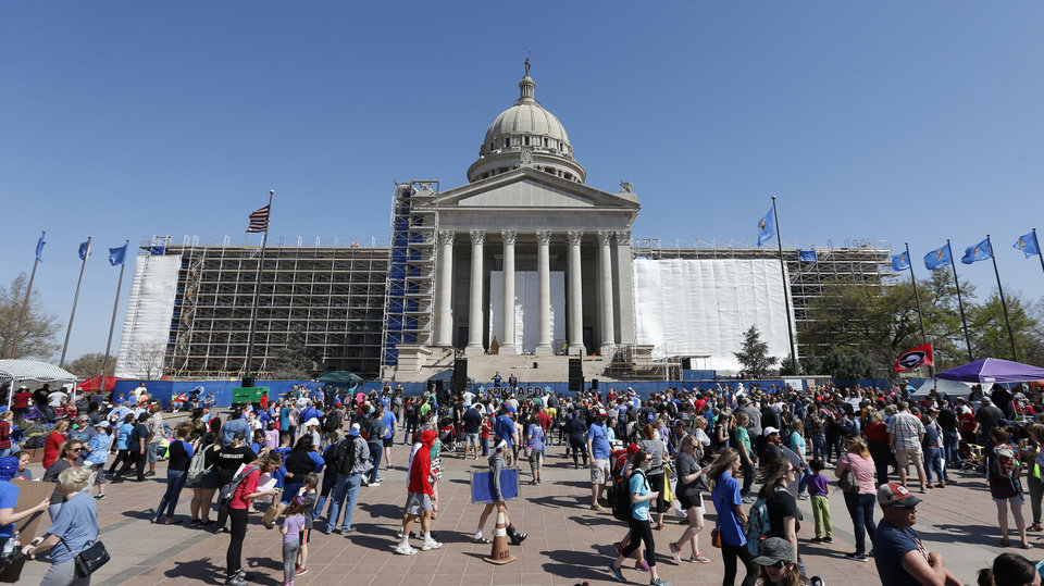 Photo - Teachers and supporters of increased education funding continue to rally on the south side of the state Capitol on the 11th day of a walkout by Oklahoma teachers in Oklahoma City, Thursday, April 12, 2018. Photo by Nate Billings, The Oklahoman