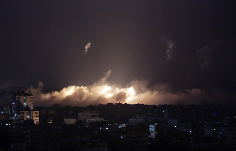 Photo - Smoke fills the skyline following Israeli shelling in Gaza City, Monday, July 28, 2014. A truce between Israel and Hamas militants in Gaza remained elusive as diplomats sought to end the fighting at the start of the Eid al-Fitr holiday, marking the end of the Muslim holy month of Ramadan. (AP Photo/Khalil Hamra)