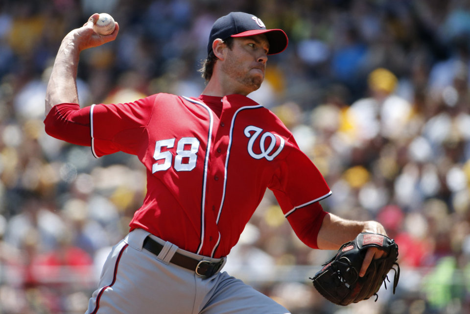Photo - Washington Nationals starting pitcher Doug Fister (58) delivers during the first inning of a baseball game against the Pittsburgh Pirates in Pittsburgh Sunday, May 25, 2014. (AP Photo/Gene J. Puskar)