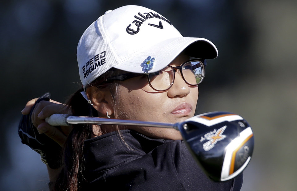 Photo - Lydia Ko, of New Zealand watches her tee shot on the 12th hole during the first round at the LPGA Kraft Nabisco Championship golf tournament Thursday, April 3, 2014, in Rancho Mirage, Calif. (AP Photo/Chris Carlson)