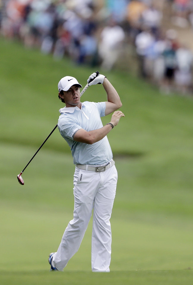 Photo - Rory McIlroy, of Northern Ireland, reacts to his shot on the second hole during the first round of the U.S. Open golf tournament at Merion Golf Club, Thursday, June 13, 2013, in Ardmore, Pa. (AP Photo/Darron Cummings)