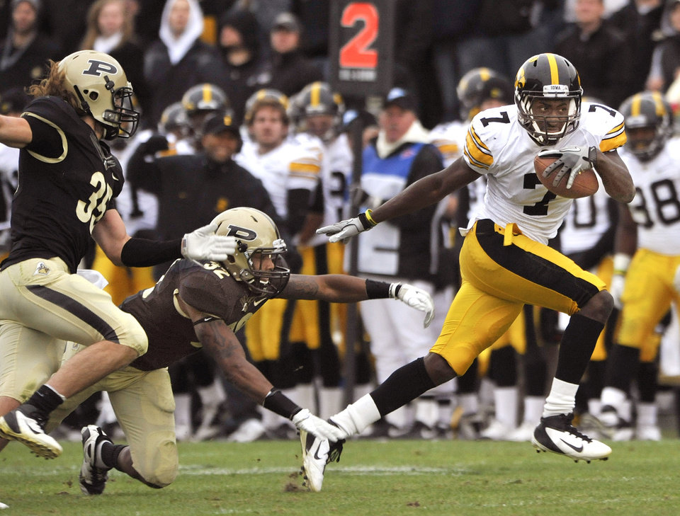 Iowa wide receiver Marvin McNutt Jr. (7) breaks free for a 51-yard touchdown reception against Purdue during their NCAA college football game, Saturday, Nov. 19, 2011, in West Lafayette, Ind. (AP Photo/Journal & Courier, Brent Drinkut) ORG XMIT: INLAF102