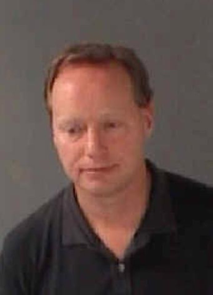 Photo - This booking photo released by the Fulton County Sheriff's Office on Thursday, Aug. 29, 2013, shows Atlanta Hawks basketball coach Mike Budenholzer. Budenholzer was arrested and charged with driving under the influence Wednesday night, Aug. 28, 2013 in Atlanta. (AP Photo/Fulton County Sheriff's Office)