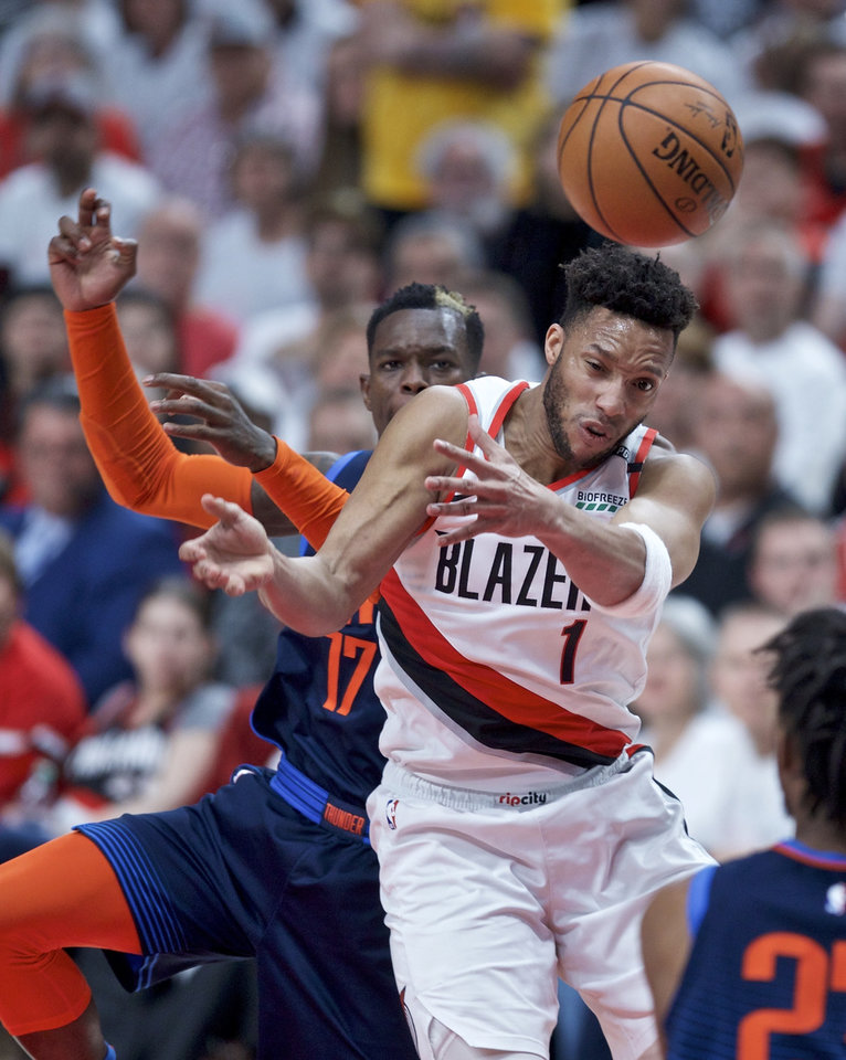 Photo - Portland Trail Blazers guard Evan Turner (1) loses the ball in front of Oklahoma City Thunder guard Dennis Schroder during the first half of Game 5 of an NBA basketball first-round playoff series, Tuesday, April 23, 2019, in Portland, Ore. (AP Photo/Craig Mitchelldyer)