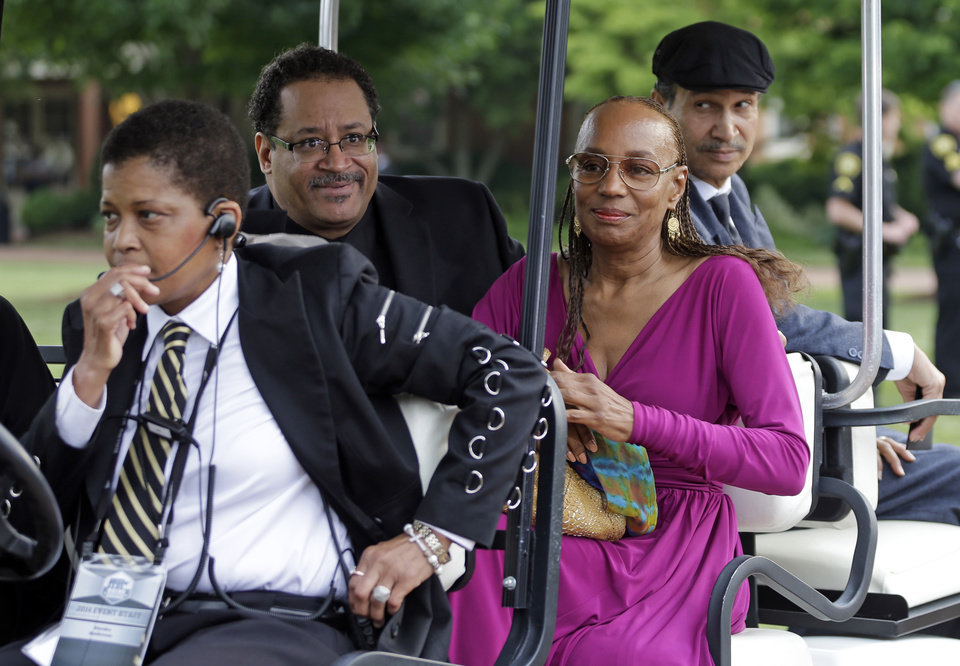 Photo - Michael Eric Dyson, second from left, and Susan L. Taylor, second from right, arrive outside Wait Chapel before a memorial service for poet and author Maya Angelou at Wait Chapel. at Wake Forest University in Winston-Salem, N.C., Saturday, June 7, 2014. Former President Bill Clinton and Oprah Winfrey are joining First Lady Michelle Obama at the service. (AP Photo/Chuck Burton)