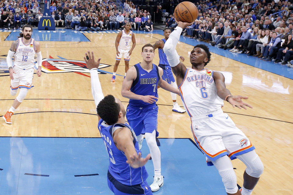 Photo - Oklahoma City's Hamidou Diallo shoots the ball as Jalen Brunson (13) and Dwight Powell (7) of Dallas defend during an NBA basketball game between the Oklahoma City Thunder and the Dallas Mavericks at Chesapeake Energy Arena in Oklahoma City, Tuesday, Dec. 31, 2019. Oklahoma City won 106-101. [Bryan Terry/The Oklahoman]