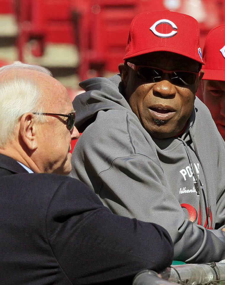 Photo -   Cincinnati Reds manager Dusty Baker, right, talks with general manager Walt Jocketty during batting practice prior to Game 4 of the National League division baseball series against the San Francisco Giants, Wednesday, Oct. 10, 2012, in Cincinnati. (AP Photo/Al Behrman)