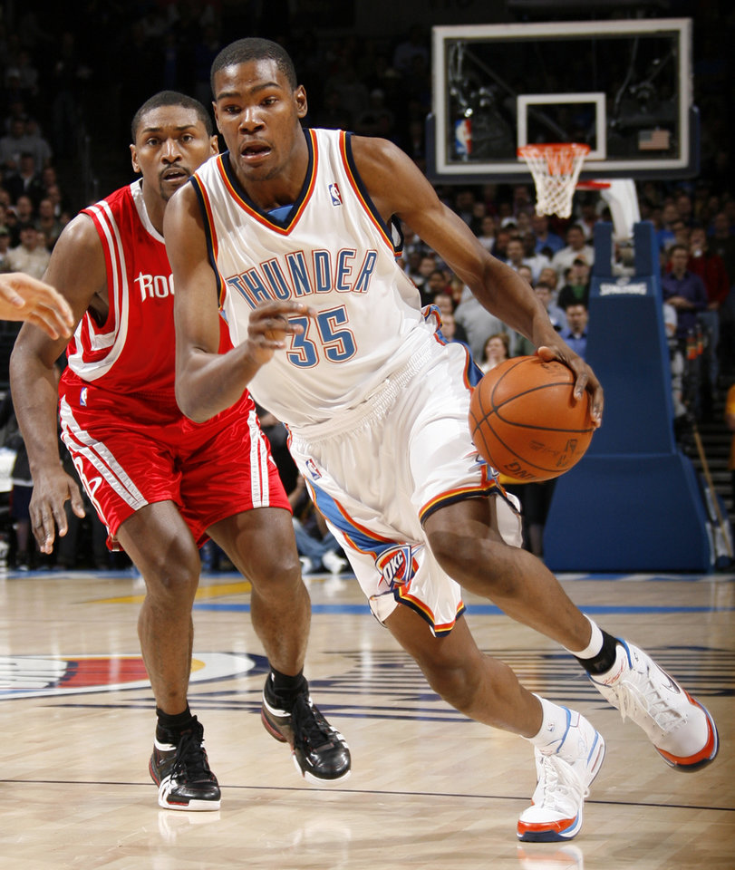 Photo - Oklahoma City's Kevin Durant (35) dribbles in front of Houston's Ron Artest (96) during the NBA basketball game between the Oklahoma City Thunder and the Houston Rockets at the Ford Center in Oklahoma City, Monday, Nov. 17, 2008. BY NATE BILLINGS, THE OKLAHOMAN ORG XMIT: KOD