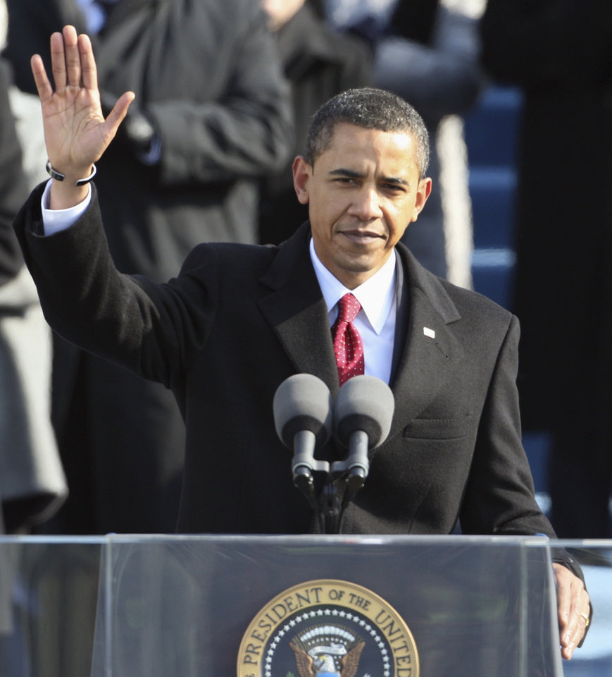 Photo - President Barack Obama waves before giving his inaugural address at the U.S. Capitol in Washington, Tuesday, Jan. 20, 2009.  (AP Photo/Ron Edmonds)