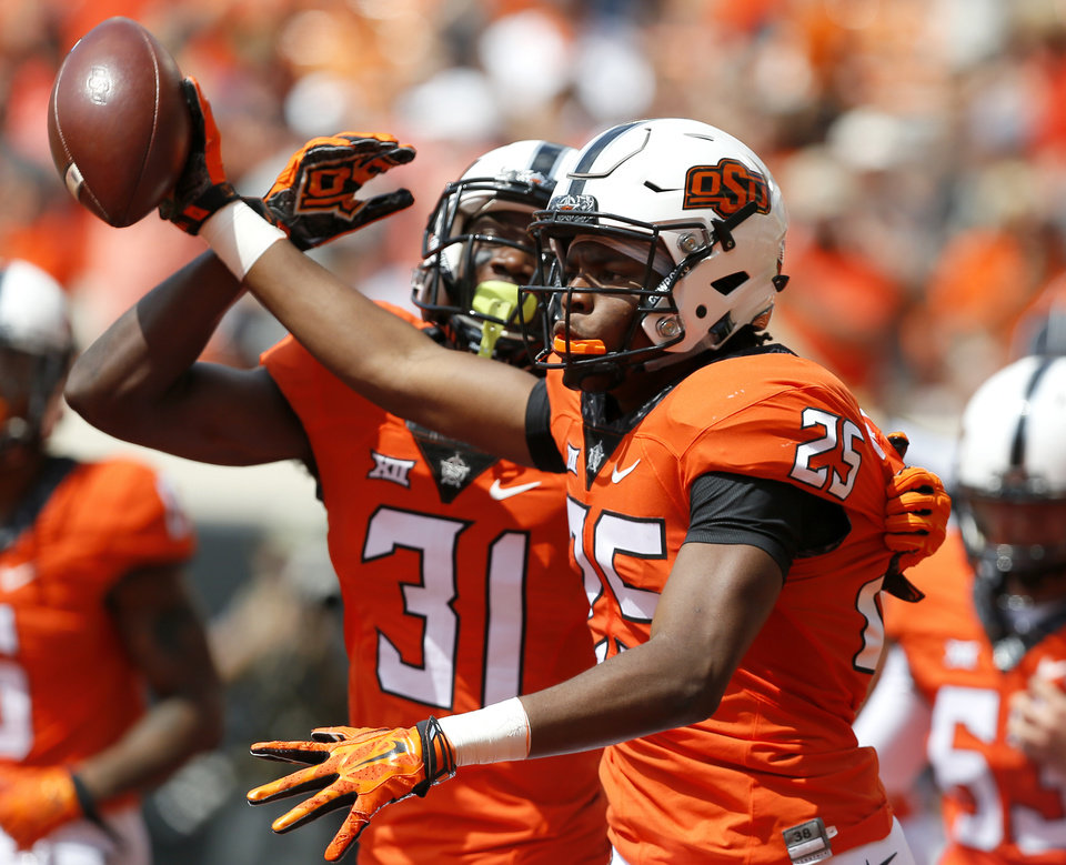 Photo - Oklahoma State's Madre Harper (25) and Tre Flowers (31) celebrates a touchdown on a fumble recovery in the first quarter during the college football game between the Oklahoma State Cowboys (OSU) and the Southeastern Louisiana Lions at Boone Pickens Stadium in Stillwater, Okla., Saturday, Sept. 12, 2015. Photo by Sarah Phipps, The Oklahoman