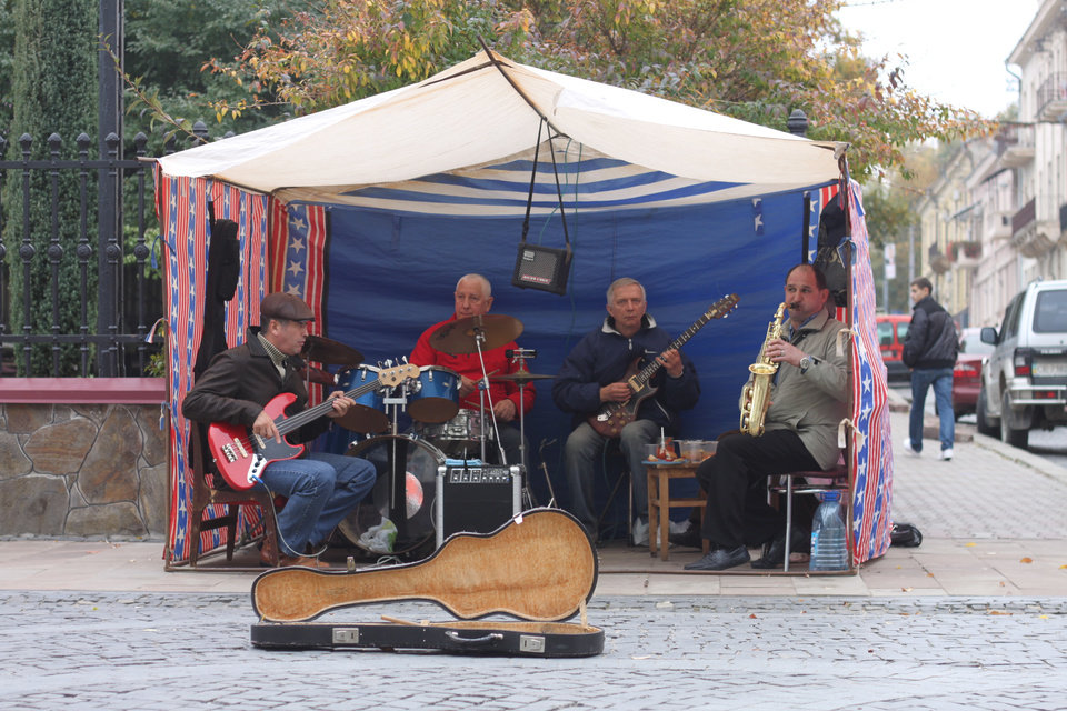 In this photo taken on Oct. 21 2012, street musicians play on the pedestrian-only Olha Kobylianska street in Chernivtsi, a city of 250,000 in southwestern Ukraine. Known as the Little Paris or, alternatively, the Little Vienna of Ukraine, Chernivtsi is a perfect place for a quiet romantic weekend trip and a crash course in the painful history of Europe in the 20th century. (AP Photo/Maria Danilova)
