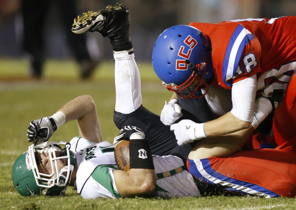 Photo - Jared Goff of Oklahoma Christian School (OCS) helps bring down Cody Noll of Jones during a high school football game in Edmond, Friday, September 14, 2012. Photo by Bryan Terry, The Oklahoman