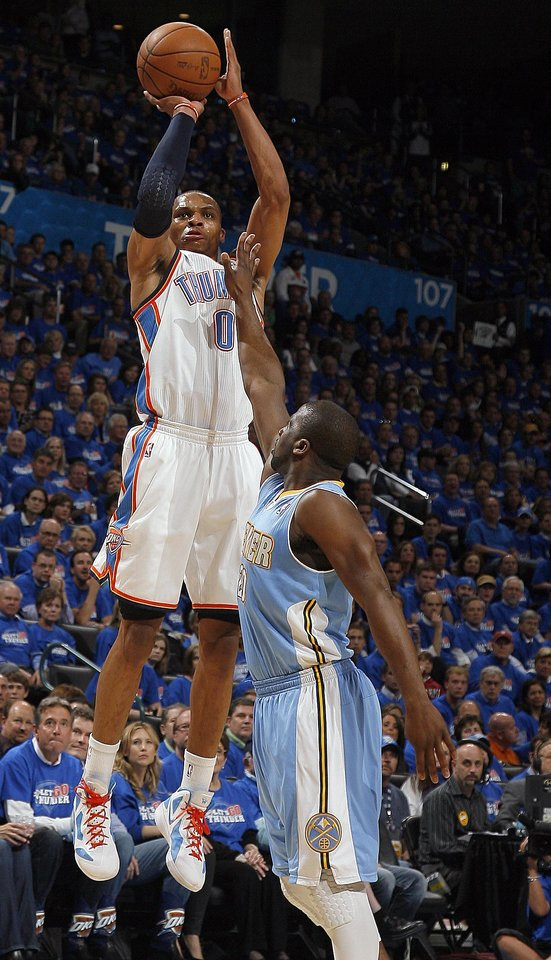 Photo - Oklahoma City's Russell Westbrook (0) shoots over Denver's Raymond Felton (20) during the first round NBA basketball playoff game between the Oklahoma City Thunder and the Denver Nuggets on Wednesday, April 20, 2011, at the Oklahoma City Arena. Photo by Sarah Phipps, The Oklahoman