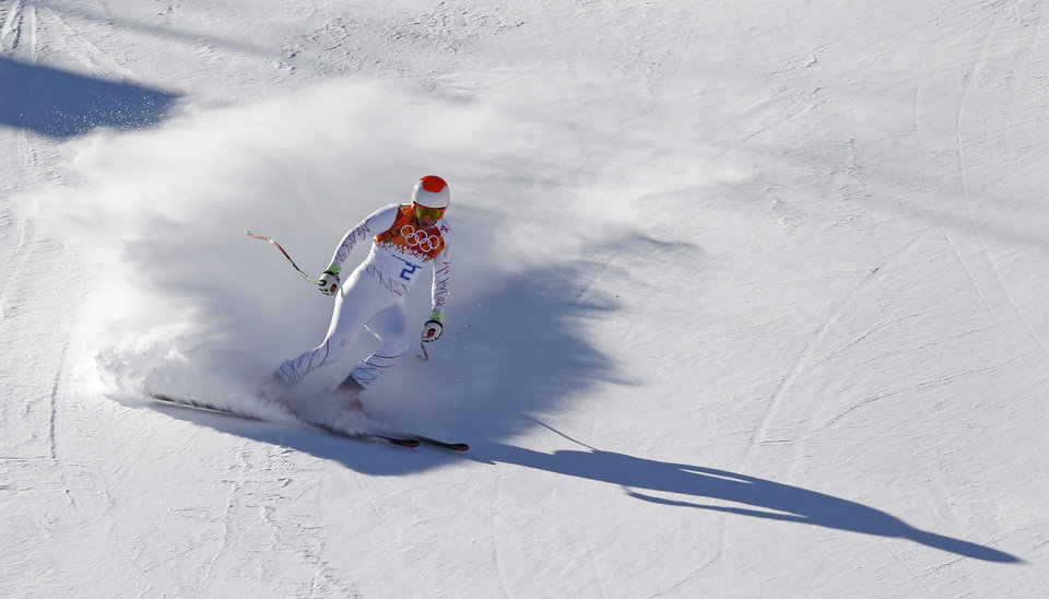 Photo - United States' Marco Sullivan comes to a halt at the end of a men's downhill training run for the Sochi 2014 Winter Olympics, Saturday, Feb. 8, 2014, in Krasnaya Polyana, Russia. (AP Photo/Christophe Ena)