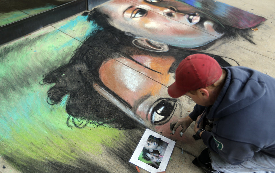 Photo - Bobby Marcee draws a sidewalk chalk piece during the Global Oklahoma, A festival of cultures, at Rose State College in Midwest City, Saturday, Oct. 6, 2012. Photo by Sarah Phipps, The Oklahoman  SARAH PHIPPS - SARAH PHIPPS