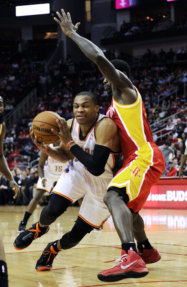 Oklahoma City Thunder's Russell Westbrook, left, tries to get past Houston Rockets' Patrick Beverley in the first half of an NBA basketball game, Wednesday, Feb. 20, 2013, in Houston. (AP Photo/Pat Sullivan)