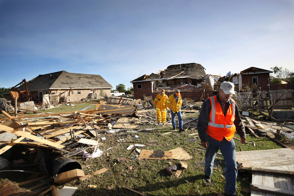 Photo - Officials search debris, Sunday, April 15,  2012.  A tornado struck Woodward early Sunday morning. Photo by Sarah Phipps, The Oklahoman.