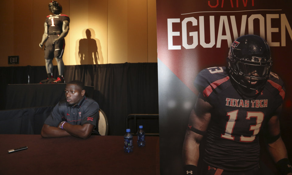 Photo - Texas Tech line backer Sam Eguavoen waits to speak to reporters during the NCAA college Big 12 Conference Football Media Days in Dallas, Monday, July 21, 2014. (AP Photo/LM Otero)