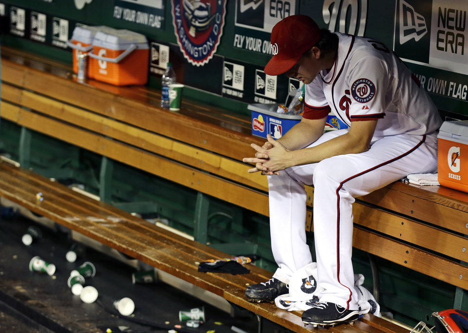 Photo -   Washington Nationals relief pitcher Tyler Clippard sits in the dugout after the second baseball game of a doubleheader against the Los Angeles Dodgers at Nationals Park, Wednesday, Sept. 19, 2012, in Washington. Clippard gave up a home run in the ninth and the Dodgers won the second game 7-6. (AP Photo/Alex Brandon)