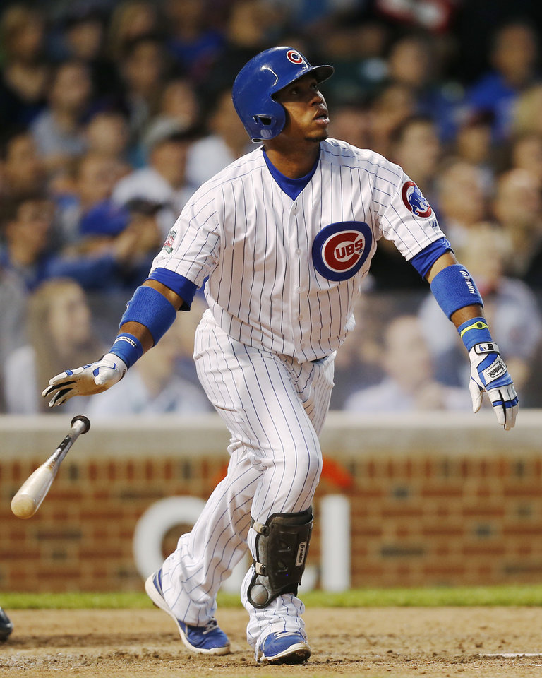 Photo - Chicago Cubs' Luis Valbuena hits a three-run home run against the San Diego Padres during the fourth inning of a baseball game on Wednesday, July 23, 2014, in Chicago. (AP Photo/Andrew A. Nelles)