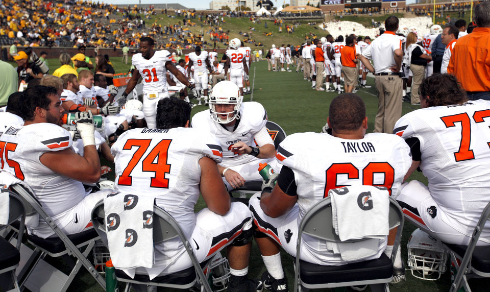 Photo - Oklahoma State's Brandon Weeden (3) talks to the offensive line during a college football game between the Oklahoma State University Cowboys (OSU) and the University of Missouri Tigers (Mizzou) at Faurot Field in Columbia, Mo., Saturday, Oct. 22, 2011. Photo by Sarah Phipps, The Oklahoman