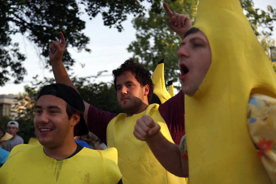 Photo - Bananas cheer on runners at Gorilla Hill during the Oklahoma City Memorial Marathon, Sunday, April 24, 2016. Photo by Sarah Phipps, The Oklahoman