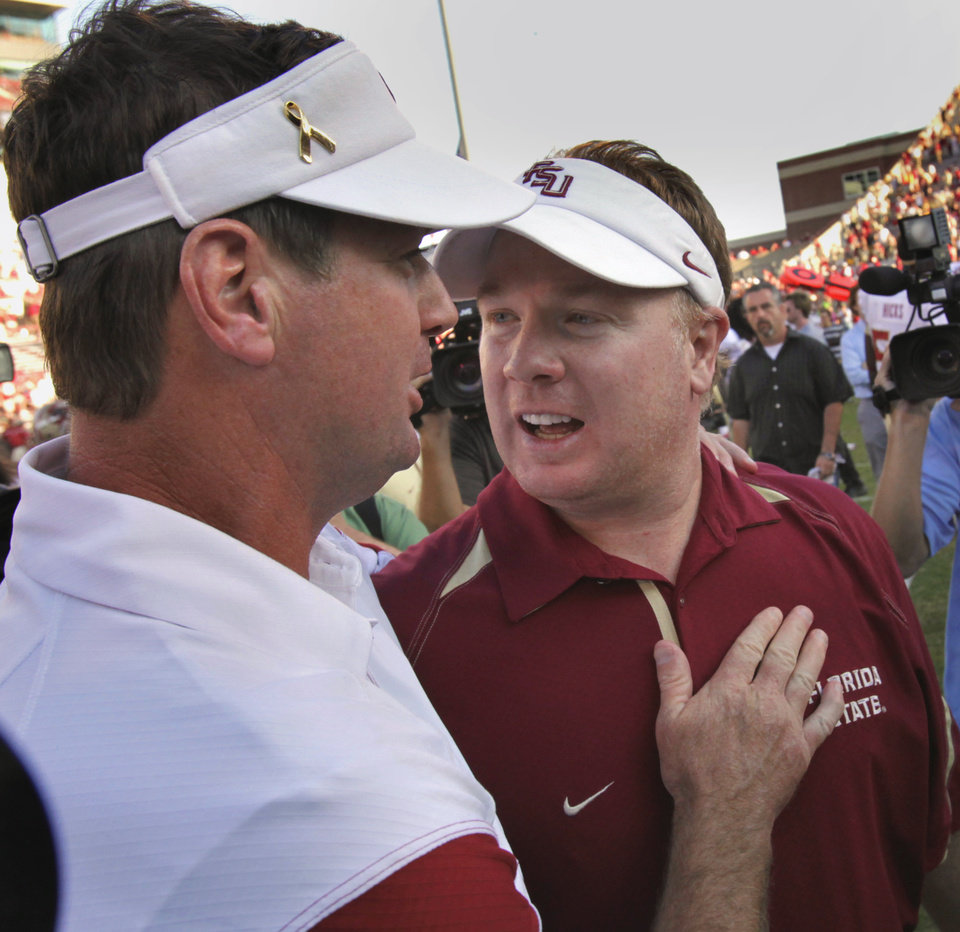 Photo - Ou head coach Bob Stoops (left) and his brother Mark greet after the college football game where the University of Oklahoma Sooners (OU) defeated the Florida State University Seminoles (FSU) 47-17 at the Gaylord Family-Oklahoma Memorial Stadium on Saturday, Sept. 11 2010, in Norman, Okla.   Photo by Steve Sisney, The Oklahoman