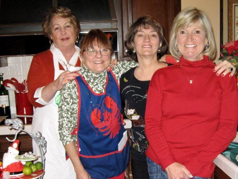 FESTIVE LOBSTER LUNCH...Brooke Phillips, Rawsie Boyles, Kanela Huff and Sue Magness get the luncheon ready for the guests. (Photo by Helen Ford Wallace).