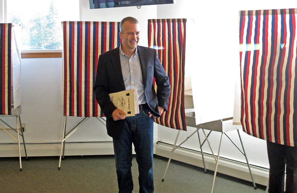Photo - Dan Sullivan, candidate for the Reublican nomination for election to the U.S. Senate, leaves the voting booth after marking his ballot in Alaska's primary election in Anchorage, Tuesday, Aug. 19, 2014. (AP Photo/Becky Bohrer)