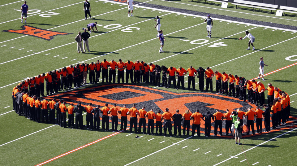 "Photo - Cowboy players meet in a ""prayer circle"" before going to the dressing room before the college football game between the Oklahoma State Cowboys (OSU) and the Central Arkansas Bears at Boone Pickens Stadium in Stillwater, Okla., Saturday, Sept. 12, 2015. Photo by Steve Sisney, The Oklahoman"