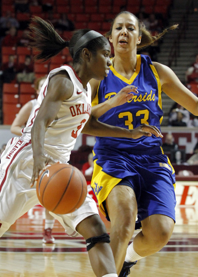 Oklahoma's Aaryn Ellenberg (3) drives past Janelle Kearney (33) as the University of Oklahoma Sooners (OU) play the Riverside Highlanders in NCAA, women's college basketball at The Lloyd Noble Center on Thursday, Dec. 20, 2012  in Norman, Okla. Photo by Steve Sisney, The Oklahoman
