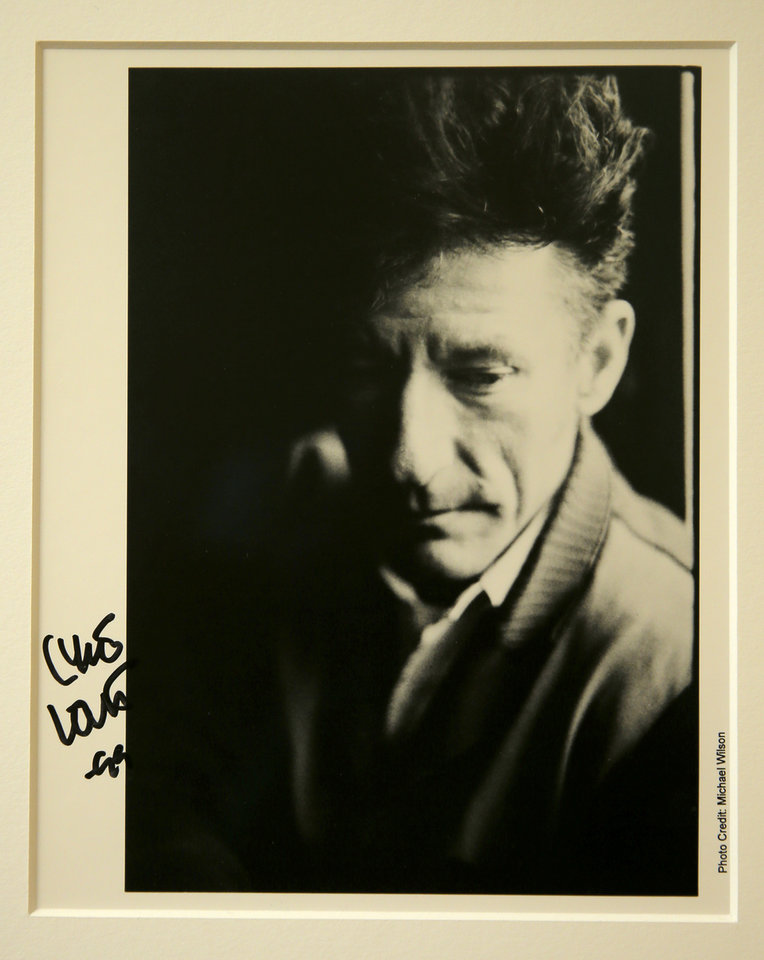 Photo -  A signed photo of Lyle Lovett hangs on the wall in the office of Dr. Stephen Prescott at the Oklahoma Medical Research Foundation. [PHOTO PROVIDED]