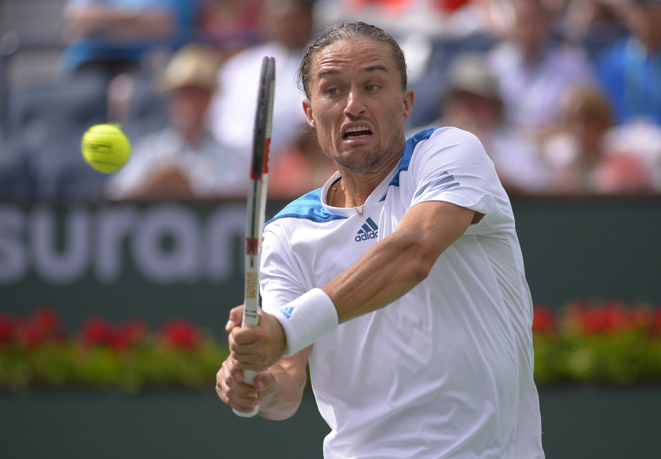 Photo - Alexandr Dolgopolov, of Ukraine, hits to Milos Raonic, of Canada, during a quarterfinal match at the BNP Paribas Open tennis tournament, Thursday, March 13, 2014, in Indian Wells, Calif. (AP Photo/Mark J. Terrill)