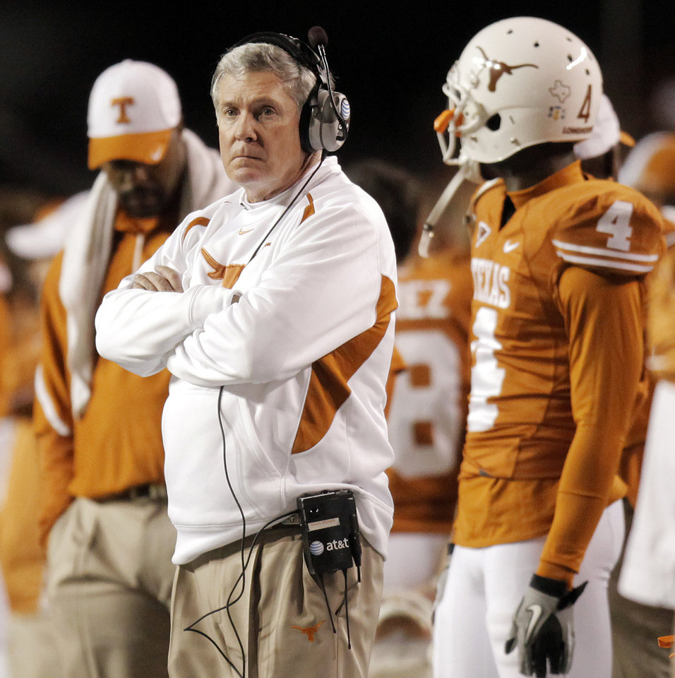 Photo - Texas head coach Mack Brown watches his team from the sideline during the college football game between the Oklahoma State University Cowboys (OSU) and the University of Texas Longhorns (UT) at Darrell K Royal-Texas Memorial Stadium in Austin, Texas, Saturday, November 13, 2010. OSU won, 33-16. Photo by Nate Billings, The Oklahoman