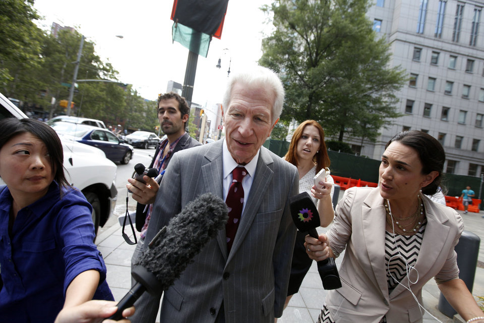 Photo - Mediator Daniel Pollack, center, leaves federal court after a hearing regarding Argentina's request to extend deadlines to repay a $1.65 billion debt to U.S. hedge funds, Friday, June 27, 2014, in New York.   Judge Thomas P. Griesa has ordered a U.S. bank to return a $539 million payment from Argentina, saying it was illegal to make. The order by the judge came Friday, three days before Argentina faces default if it fails to pay $832 million to the majority of its debt holders. (AP Photo/Jason DeCrow)