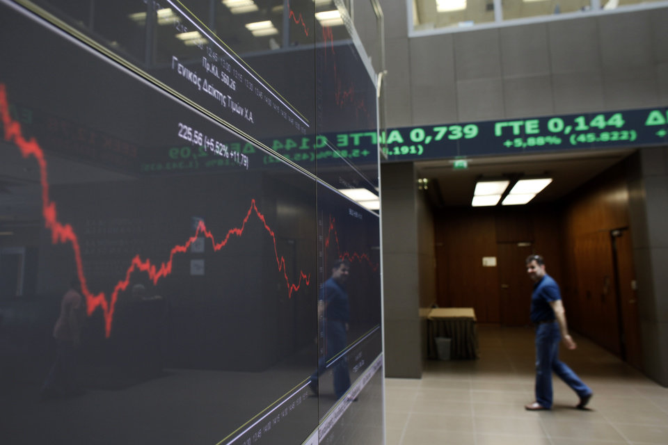 Photo -   A man walks as above screens showing rising stocks in green as he is reflected in the chart with stock prices at the Greek Stock Exchange in Athens, on Monday , June 18, 2012. In Athens, stocks lost initial strong gains but were still 4.5 percent up in afternoon trading, on the back of strong gains last week that anticipated the conservative victory. (AP Photo/Kostas Tsironis)