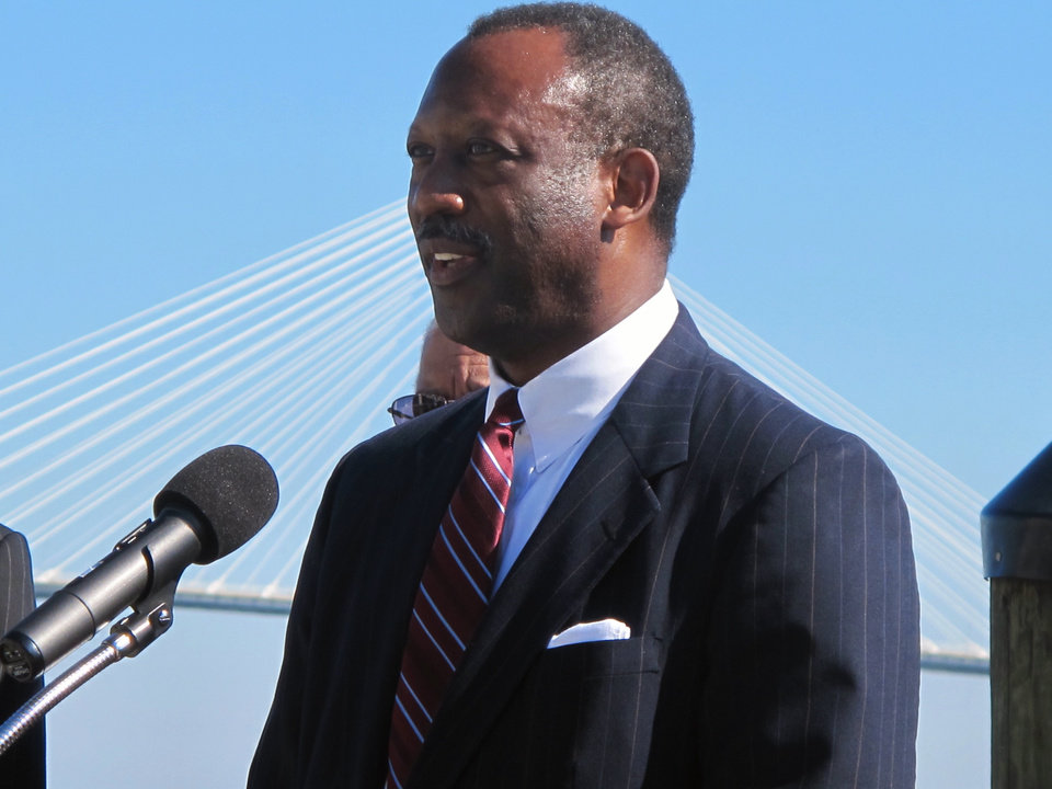 Photo - Wilbur Johnson, the chairman of the board of the International African American Museum, discusses updated plans for the museum during a news conference on the waterfront in Charleston, S.C., on Wednesday, Oct. 23, 2013. Mayor Joseph P. Riley Jr. said the $75 million museum will be financed with a combination of city, county and state funds as well as private donations. Construction is expected to begin in about two years. (AP Photo/Bruce Smith)