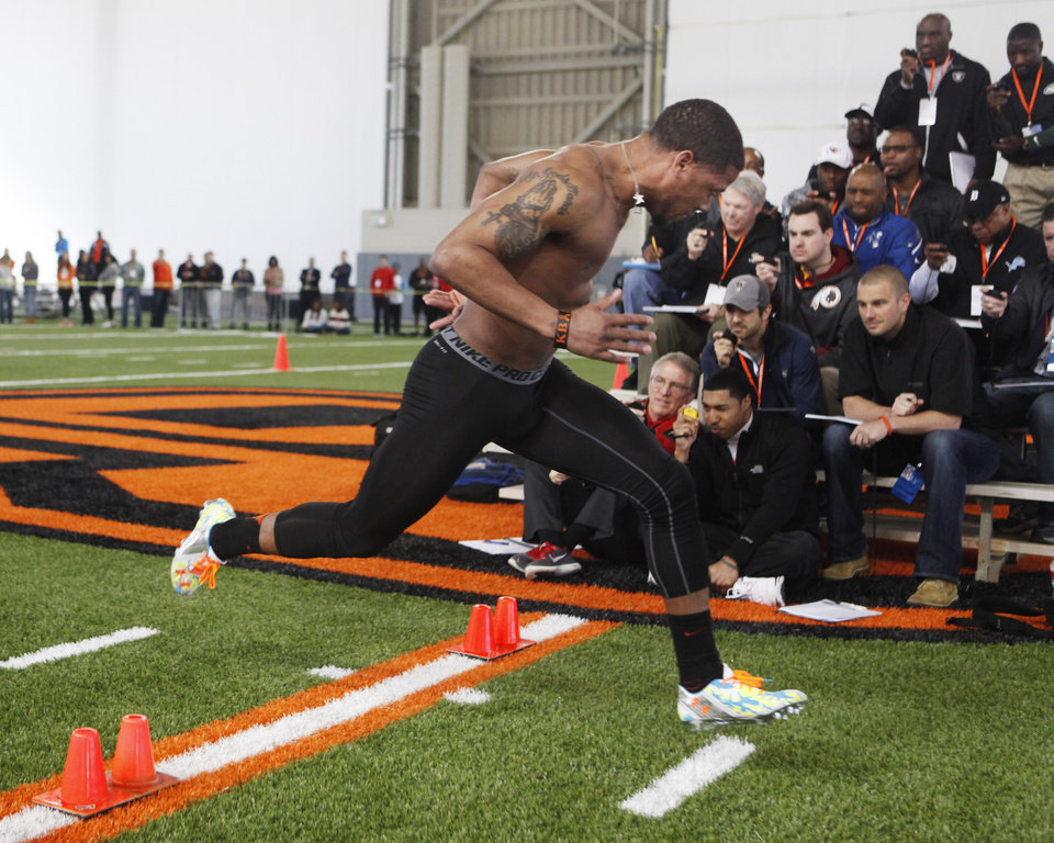 Photo - Receiver Josh Stewart crosses the finish line of the 40 yard dash during a workout at Oklahoma State's pro day held at Boone Pickens Stadium in Stillwater on Thursday, March 13, 2014. Photo by KT King, The Oklahoman