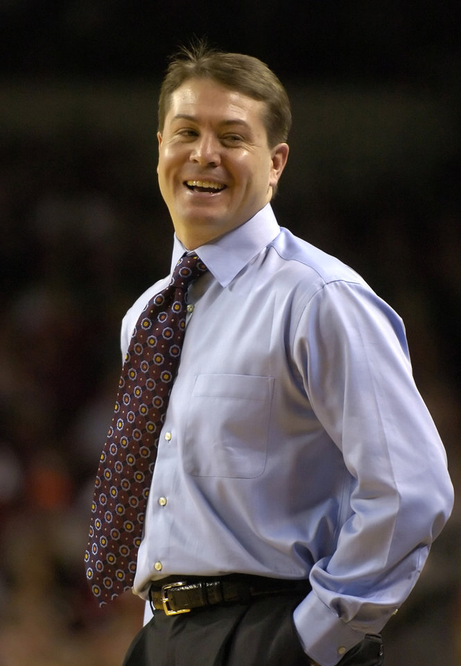 Photo - Eastern Kentucky University head college basketball coach Travis Ford reacts following a call by the referee during action of their game against Louisville Thursday Dec. 30, 2004 at Freedom Hall in Louisville, Ky.  (AP Photo/Timothy D. Easley) ORG XMIT: KYTE105 ORG XMIT: 0804162207578361
