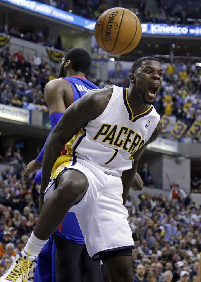Photo - Indiana Pacers guard Lance Stephenson reacts after a dunk against the Detroit Pistons in the second half of an NBA basketball game in Indianapolis, Monday, Dec. 16, 2013. The Pistons defeated the Pacers 101-96. (AP Photo/Michael Conroy)