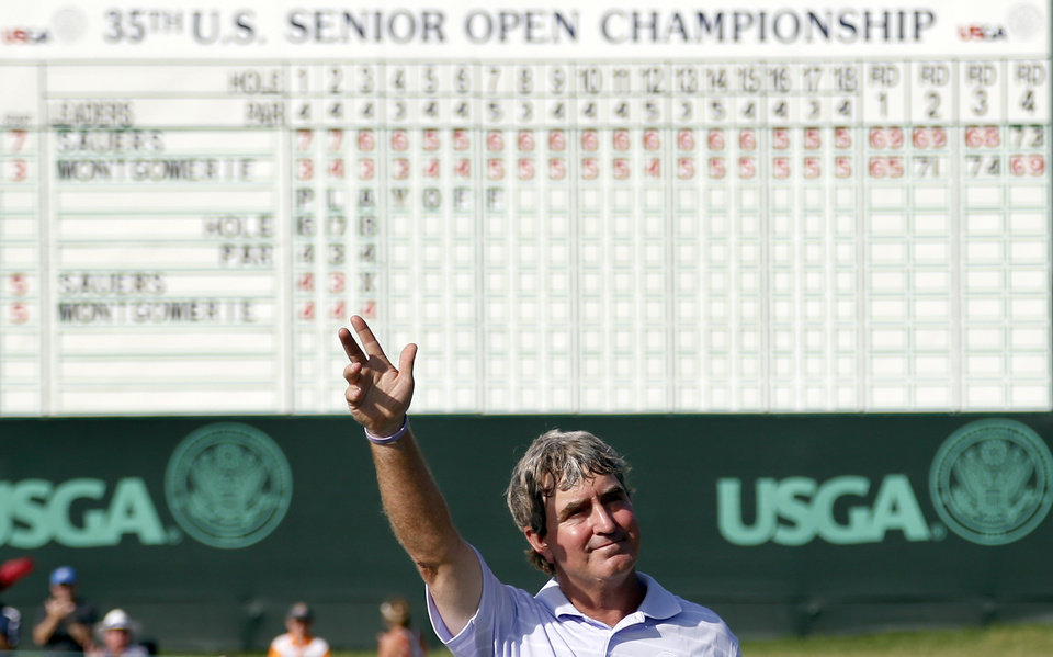 Photo - Gene Sauers waves to the crowd followingbthe final round of the U.S. Senior Open golf tournament at Oak Tree National in Edmond, Okla., Sunday, July 13, 2014. Photo by Sarah Phipps, The Oklahoman