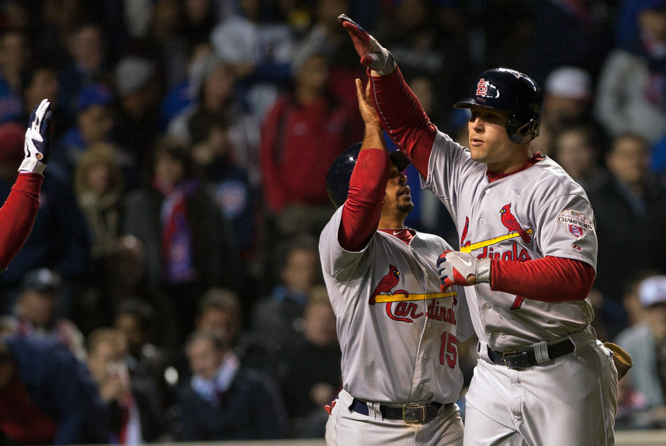 Photo -   St. Louis Cardinals' Matt Holliday gets a high five from teammate Rafael Furcal after hitting a two-run home run during the eighth inning of a baseball game in Chicago on Tuesday, April 24, 2012. (AP Photo/Charles Cherney)