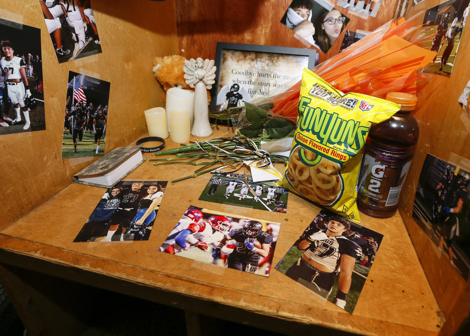 Photo -  Photos and other items in Kayson Toliver's locker, after Monday's football practice for the Beggs Golden Demons. The 18-year-old Beggs senior running back was shot and killed on Nov. 1. [Photos by Nate Billings, The Oklahoman]