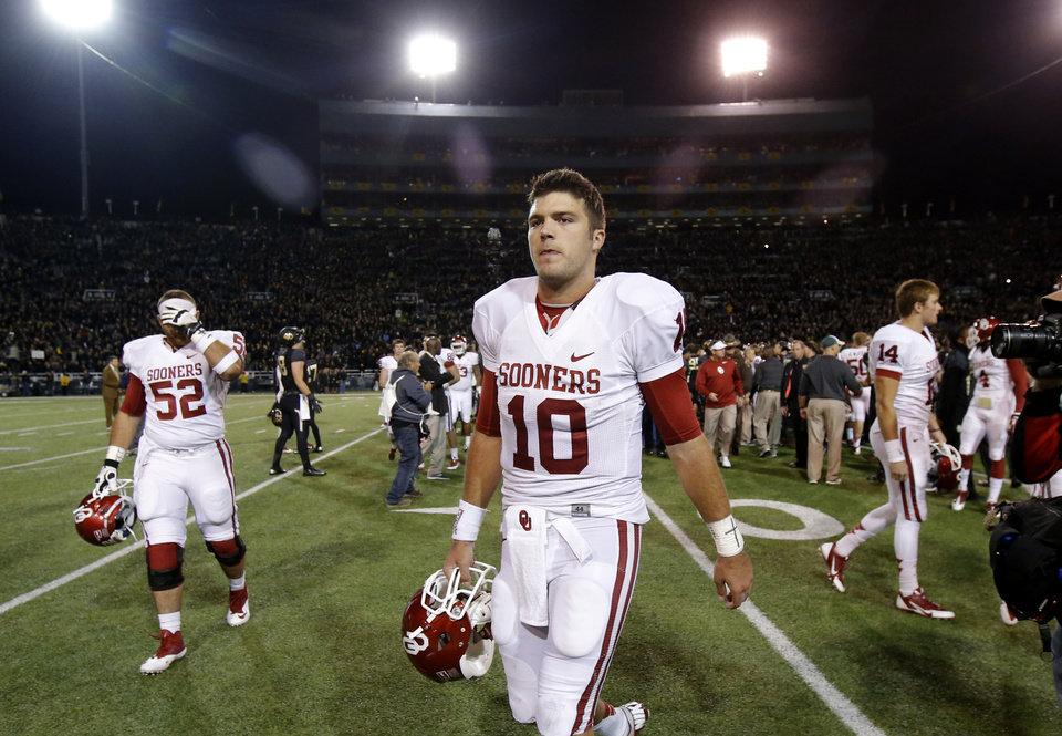 Oklahoma\'s Blake Bell (10) walks off the field after an NCAA college football game between the University of Oklahoman (OU) Sooners and the Baylor Bears at Floyd Casey Stadium in Waco, Texas, Thursday, Nov. 7, 2013. Baylor won 41-12. Photo by Bryan Terry, The Oklahoman