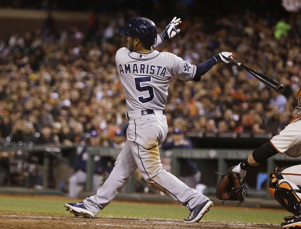 Photo - San Diego Padres' Alexi Amarista follows through on a two-run single off San Francisco Giants starting pitcher Tim Hudson in the sixth inning of a baseball game Tuesday, June 24, 2014, in San Francisco. (AP Photo/Eric Risberg)