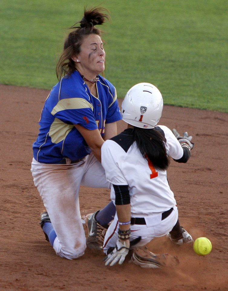 Photo - Tulsa's Samantha Cobb can't hold onto the ball as Oregon's Ya Garcia steals second base in the 10th inning of an NCAA softball regional at the OU softball complex in Norman, Okla., Friday, May 18, 2012. Tulsa won 9-7.  Photo by Bryan Terry, The Oklahoman