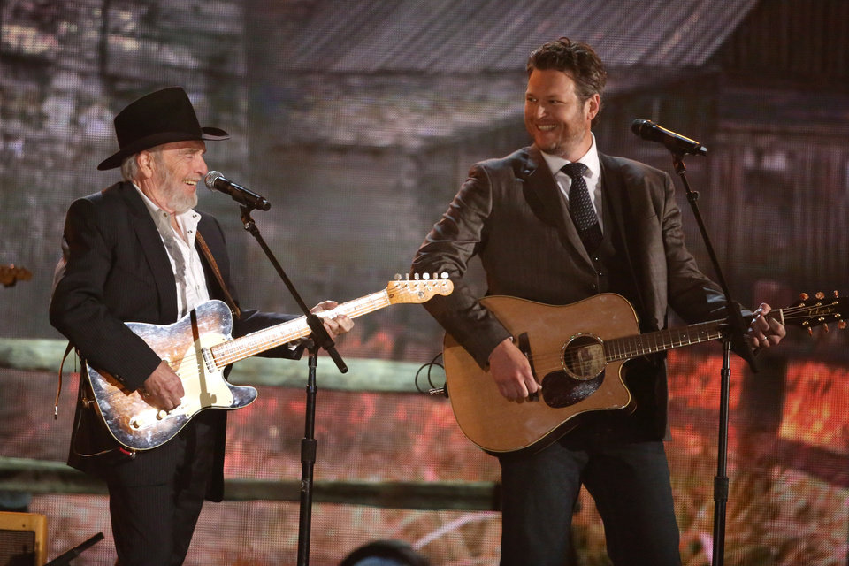 Photo - Merle Haggard, left, and Blake Shelton perform on stage at the 56th annual Grammy Awards at Staples Center on Sunday, Jan. 26, 2014, in Los Angeles. (Photo by Matt Sayles/Invision/AP)