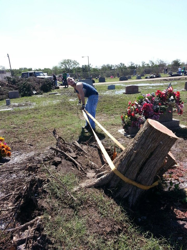 Volunteers clean the Moore Cemetery of debris following this week's violent tornado. PHOTO BY ED GODFREY, THE OKLAHOMAN