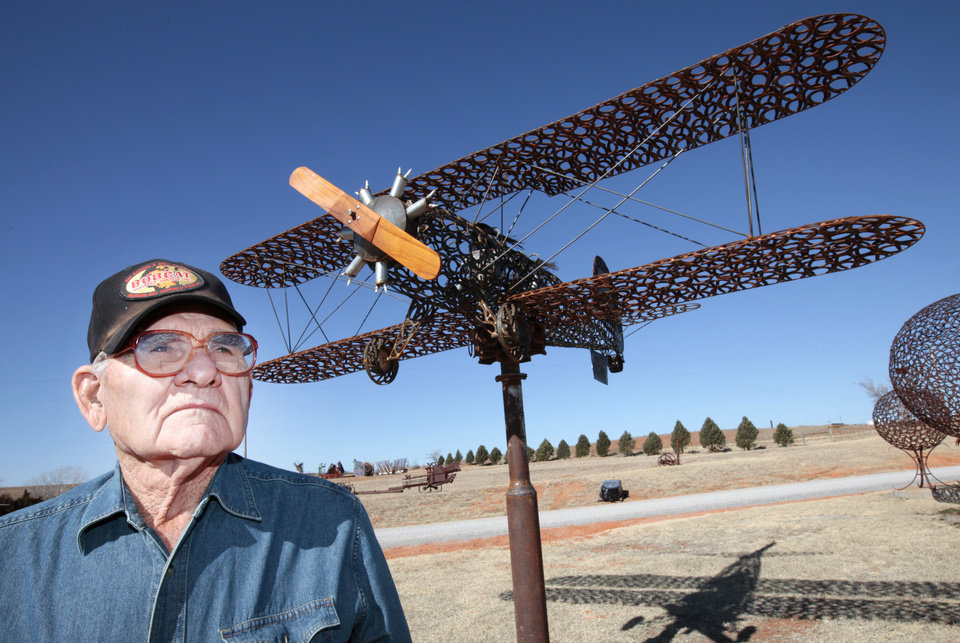 Joe Smith, 86, used horseshoes to build a half-size replica of a Stearman PT-17 Kaydet biplane at his home near Leedey. Besides horseshoes, Smith has used wheelbarrows, wrenches, steam engines and a lot of other metals to build decorated fences, weather vanes, kachina dolls and an eagle perched on the edge of a nest. Photo by David McDaniel, The Oklahoman