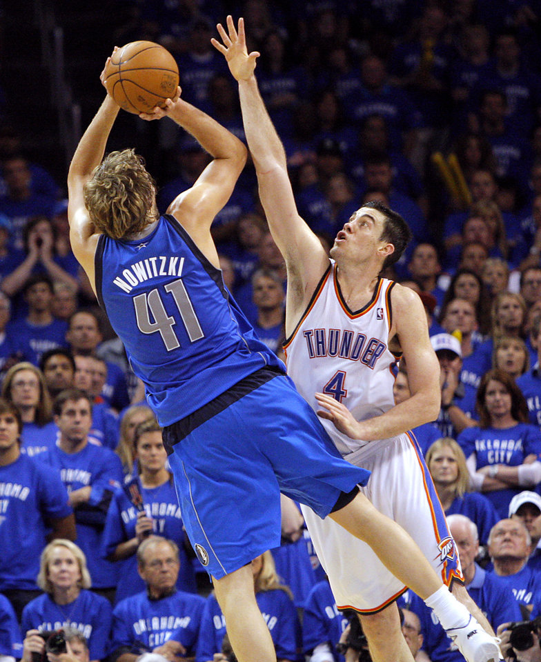 Dirk Nowitzki (41) of Dallas puts a shot over Oklahoma City's Nick Collison during game 4 of the Western Conference Finals in the NBA basketball playoffs between the Dallas Mavericks and the Oklahoma City Thunder at the Oklahoma City Arena in downtown Oklahoma City, Monday, May 23, 2011. The Thunder lost game 3 to the Mavericks 112-105. Photo by John Clanton, The Oklahoman